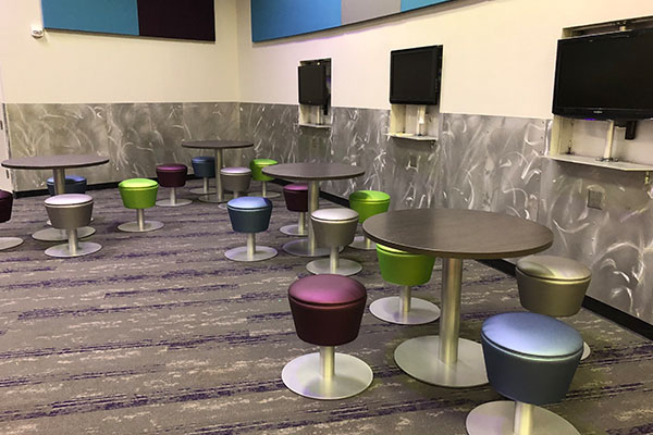 Collaborative Area Vinyl Stools and Disc Base Tables